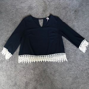 Navy blue blouse with cream crochet detail
